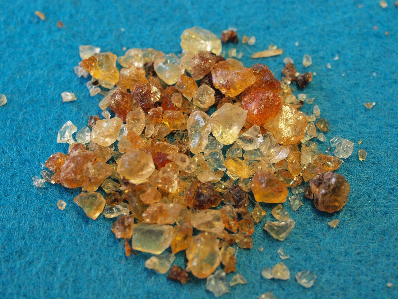 Pile of gum arabic on blue fabric